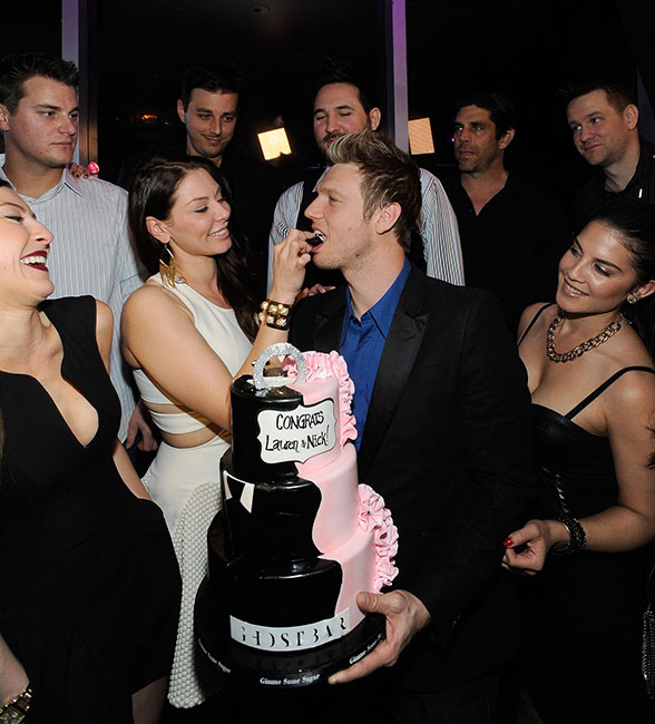 Lauren-Kitt-feeds-Nick-Carter-cake-at-Ghostbar-(David-Becker)