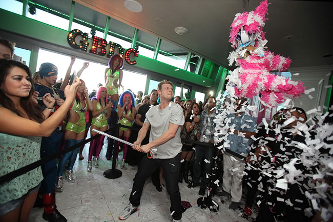Nick-Carter-hitting-pinata-at-Ghostbar-Dayclub-(Joe-Fury)